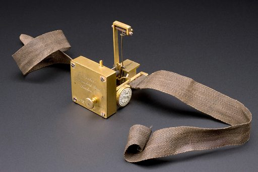 Robert Dudgeon's sphygmograph, London, England, 1876. Blood pressure is measured and recorded using a sphygmograph. It is strapped to the wrist. The pulse beat is transmitted to a lever which records it on smoked paper. The first efficient sphygmograph was designed by Étienne-Jules Marey (1830–1904) in 1863. This example belonged to Dr Robert Ellis Dudgeon (1820–1904). He was a prominent figure in homeopathy. Dudgeon also made his own changes to Marey's original design. It was made by instrument maker J Gauter in 1876. In the late 1800s, physiology teachers used sphygmographs to visually demonstrate blood pressure. Instruments such as this were also valuable diagnostic aids. They were the predecessor of the modern arm cuffs physicians now use to measure blood pressure. Contributors: Science Museum, London. Work ID: qqmvmef2.