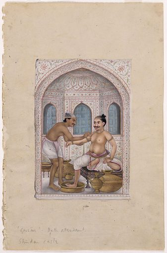 A masseur massaging the arm of a man who is sitting on a low stool, with a leg immersed in a brass basin