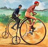 Cyclists racing on Penny Farthing bicycles