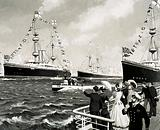 A small, 100-foot craft dashed between the formidable warships during the 1897 Naval review