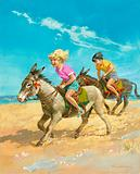 Boy and girl riding donkeys on the beach