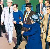 Lee Harvey Oswald being killed by Jack Ruby