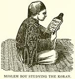 Muslem Boy studying the Koran