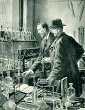 M Curie chatting with Sir William Ramsay