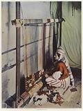 A woman weaving a tapestry on a loom in Tunisia