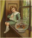 A young boy dangling a fishing rod into a bowl of goldfish