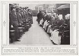 Women as fire-fighters in war-time, a drill scene at a London workhouse