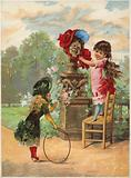 Girl putting bonnet on statue; another girl with hoop