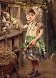 Little girl feeding rabbits