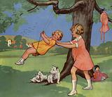 Girls playing on swing in English countryside