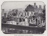 Women brickmakers loading barges