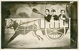 Three people riding a photo prop cart
