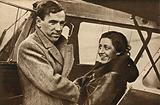 British aviator Amy Johnson bidding farewell to her husband, Jim Mollison, before setting off on her record-breaking flight to South Africa, 1932