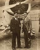 American aviators Wiley Post and Harold Gatty in front of Winnie Mae, the aircraft in which they flew around the world in nine days in 1931