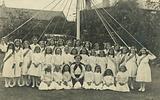 Schoolgirls and teacher