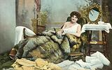 Woman posing on chaise longue