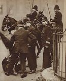 Police detaining a rioter during a hunger march by unemployed workers in London, 1932