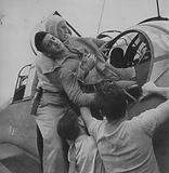 Aircrewman Wounded in Strike on Rabaul, Aircraft Carrier USS Saratoga, 5 November 1943