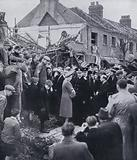 King George VI and Queen Elizabeth inspecting damage caused by a German air raid on the East End of London, World War II