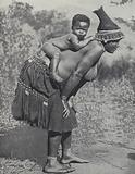 Woman carrying her baby on her back, South Africa