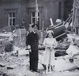 King George VI and Queen Elizabeth standing in the rubble of Buckingham Palace, London, after the bombing in 1940