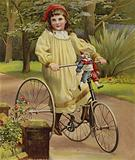 Girl riding her tricycle in the garden