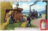 Steam-powered threshing machine on a farm