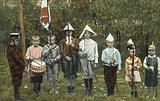 Group of boys playing soldiers