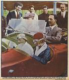 Prince Umberto and Princess Marie of Italy behind the wheels of the cars of Italian racing drivers Attilio Marinoni …