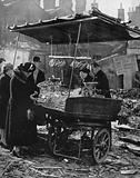 In 1940 a fruit stall open in the debris of the blitz in London