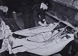 Children sleeping in hammocks in the London Underground during a German air raid, World War II, 1940–1941