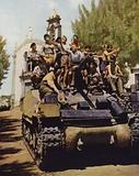 Tank of the British Eighth Army giving a ride to a group of children, Milo, Sicily, Italy, World War II, August 1943