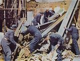 Rescue workers clearing debris from a bombed building in Amen Court, City of London, after a major German incendiary …