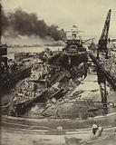 American destroyers USS Downes and USS Cassin and the battleship USS Pennsylvania damaged in the Japanese attack on …