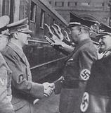 Nazi leader Adolf Hitler greeted by Conrad Henlein, leader of the Nazi Party in the Sudetenland, on Hitler's return to …