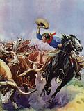 Cowboy riding alongside a stampeding herd of cattle