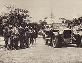 Albert I, King of the Belgians travelling by car on the roads of Uele, Belgian Congo