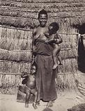 Congolese mother with her children, Belgian Congo
