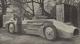 Sir Malcolm Campbell with Blue Bird, the car in which he broke the Land Speed Record in 1933