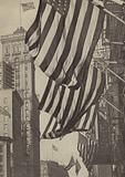 The Stars and Stripes flying on Broadway and 42nd Street, New York City, on Armistice Day, 11 November 1918