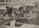 American soldiers charging German dummies during bayonet training