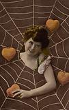 Girl at the centre of a web surrounded by hearts