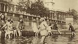 Children enjoying a paddle in Trafalgar Square during a heatwave