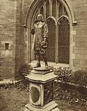 Statue of the poet John Milton outside his burial place, the Church of St Giles Cripplegate, in the City of London