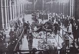 The coffin of the Unknown Warrior lying in state in Westminster Abbey before burial on Armistice Day, 1920