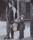 Charlie Chaplin and Jackie Coogan in a scene from Chaplin's film The Kid, 1921
