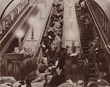 Londoners sleeping on the escalators of an underground station during an air raid, World War II, 1940