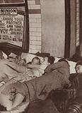 Londoners sleeping on an underground station platform during an air raid, World War II, 1940