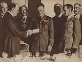 Secretary of State for Air Winston Churchill presenting John Alcock and Arthur Whitten Brown with a £10,000 prize for successfully completing the first transatlantic flight, 1919