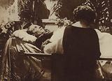 Eva Miller praying by the coffin of actor and film star Rudolph Valentino as he lies in state in the Broadway Chapel, New York, 1926